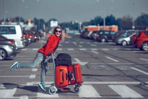 woman-walking-into-airport