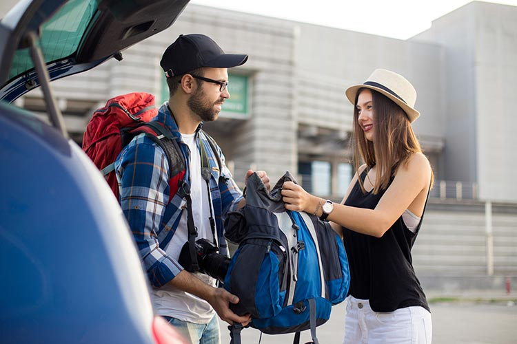 Couple Unloading in an Airport Parking Lot